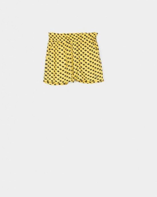 """Шорты желтого цвета в мелкий черный принт """"губки"""""""