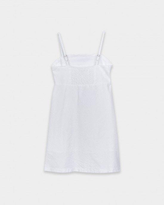 Сарафан белого цвета с асимметричной планкой и пуговицами