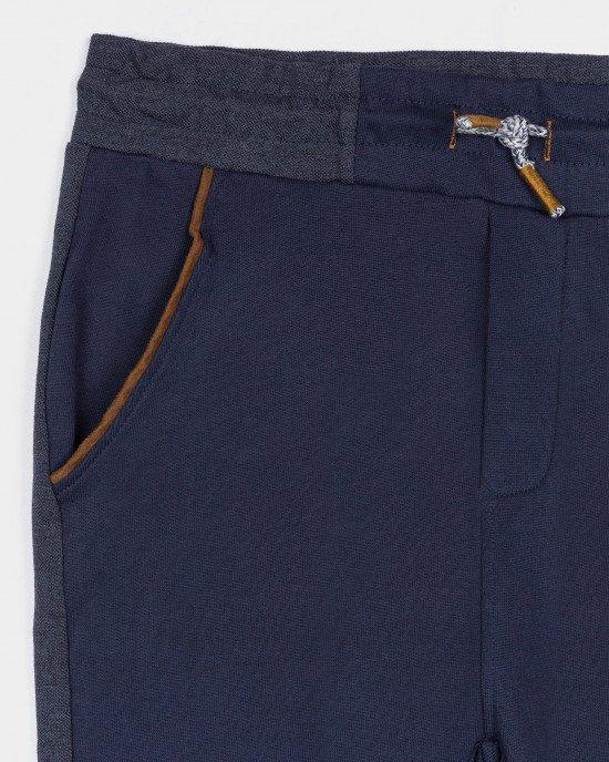 Брюки спортивные синего цвета с утягивающим шнурком в поясе