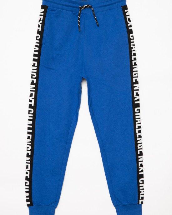 Штаны спортивные синего цвета с черно - белыми лампасами