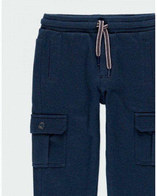 Брюки спортивные синего цвета с накладными карманами