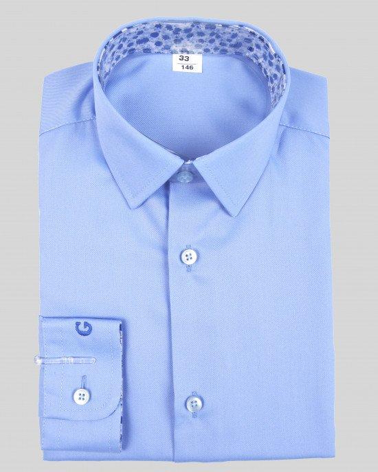 Рубашка синего цвета с вышитым логотипом на манжете